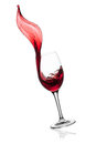 Red wine splashing from glass. Royalty Free Stock Photo