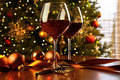 Red wine on table with Christmas tree Royalty Free Stock Photo