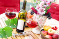 Red wine on the terrace autumn with Royalty Free Stock Photography