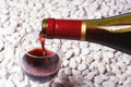 Red wine on the white stone Stock Photos