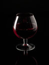Red wine and wineglass beautiful glass Royalty Free Stock Photo
