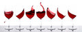 Red wines in a row with white background Royalty Free Stock Photos