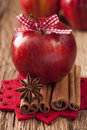 Red winter apples with cinnamon sticks and anise Stock Photos