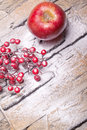 Red winter berries and christmas apple with  powder snow Stock Photos