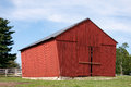 Red wooden barn a on a rock foundation Stock Image