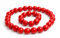 Red wooden beads and bracelet isolated on a white background Royalty Free Stock Image