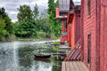Red wooden buildings by a river Stock Photography
