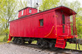 Red wooden caboose an old railroad on track Stock Photo