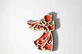 Red wooden christmas angel ornament on white Royalty Free Stock Photo