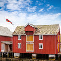 Red wooden coastal house in norway and yellow norwegian fishing village rorvik Stock Photos