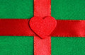 Red wooden decorative heart on green cloth background valentine s day love symbol textile with ribbon blank copy space Royalty Free Stock Photography