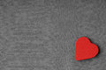 Red wooden decorative heart on grey gray cloth background. Royalty Free Stock Photo
