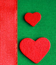 Red wooden decorative hearts on green cloth background valentine s day love symbol textile with ribbon blank copy space Royalty Free Stock Photo