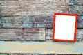 Red wooden frame hanging on a wooden board Royalty Free Stock Photo