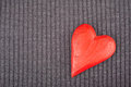 Red wooden heart on knitted background copy space toned image Royalty Free Stock Photography