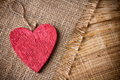 Red wooden heart on a linen cloth and wood background Royalty Free Stock Photos