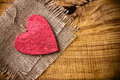 Red wooden heart linen cloth wood background Stock Image