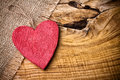 Red wooden heart on a linen cloth and wood background Stock Image