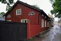 Red wooden house old on narrow street of ancient tammisaari ekenas finland at rainy day Royalty Free Stock Images