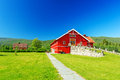 Red wooden house with orange door barn Stock Photos