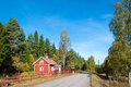 Red wooden house in sweden the woods of smalöand Royalty Free Stock Photography