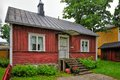Red wooden house traditional at rainy day tammisaari finland Stock Images