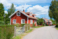 Red wooden houses in Pataholm, Sweden Royalty Free Stock Images