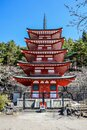 Red wooden pagoda near the Fuji mountain in Japan Royalty Free Stock Photo