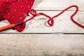 Red woollen string and chrochet hook on wood, Hobby Handiwork Royalty Free Stock Photo