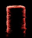 Red yarn coil of in dark reflective back Royalty Free Stock Photography