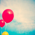 Red and yellow balloons flying in the sky Royalty Free Stock Image