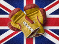 Red and yellow boxe gloves on union jack flag old Stock Images