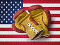 Red and yellow boxe gloves on usa flag old Royalty Free Stock Images