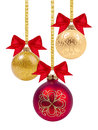 Red and yellow christmas balls with ribbon and bow on white Royalty Free Stock Photos