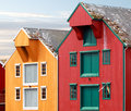 Red and yellow coastal wooden houses in norway with seagulls nests on roofs Stock Image