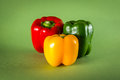 Red yellow and green pepper on a background Royalty Free Stock Photography