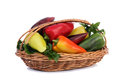 Red, yellow and green pepper in a basket on a white background. Royalty Free Stock Photo