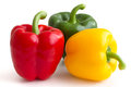 Red yellow and green peppers on white background Stock Photography