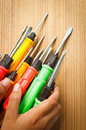 Red yellow green screw driver on the wood Royalty Free Stock Photography