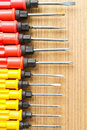 Red yellow green screw driver on the wood Stock Image