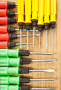 Red yellow green screw driver on the wood Royalty Free Stock Photo