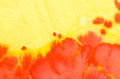 Red and yellow painted crepe paper background Royalty Free Stock Photo