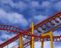 Red yellow roller coaster blue sky Royalty Free Stock Images
