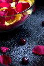 Red and yellow roses petals in glass bowl Royalty Free Stock Photo
