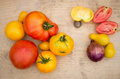 Red and yellow tomatoes on wooden board Stock Images