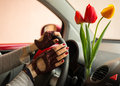 Red and yellow tulips bring joy women when driving