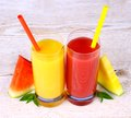 Red and yellow watermelon juice with straw close up Royalty Free Stock Photo