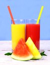 Red yellow watermelon and juice with straw vertical Royalty Free Stock Photo