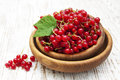 Redcurrant bowl with on a wooden background Stock Photography