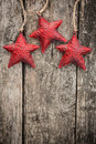 Redd christmas tree decorations on grunge wood red background winter holidays concept copy space for your text Royalty Free Stock Image